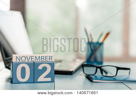 November 2nd. Day 2 of month, calendar on business office background. Autumn concept. Empty space for text.