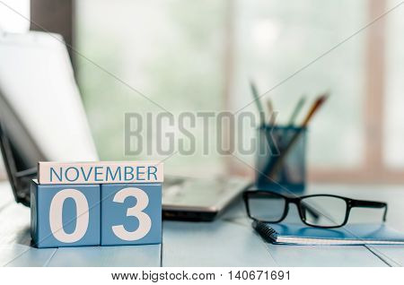 November 3rd. Day 3 of month, calendar on insurance agent workplace background. Autumn time. Empty space for text.