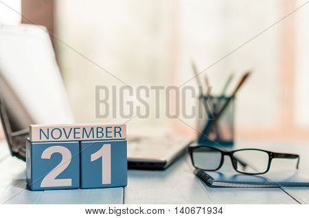 November 21st. Day 21 of month, calendar on teacher table background. Autumn time. Empty space for text.