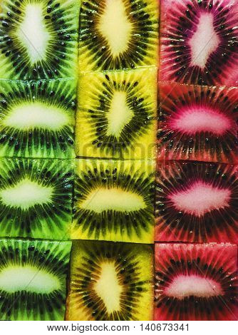 Colorful slices cube kiwi, green, yellow and red