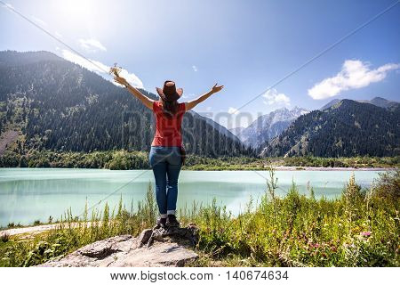 Tourist Woman On The Lake At The Mountains