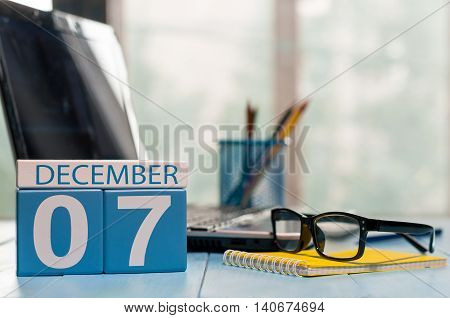 December 7th. Day 7 of month, calendar on CEO workplace background. Winter time. Empty space for text.