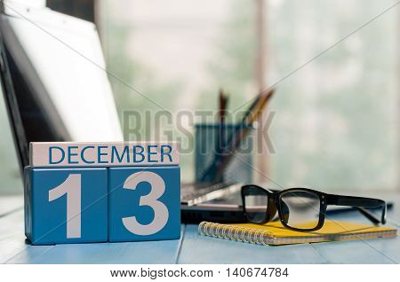 December 13th. Day 13 of month, calendar on designer workplace background. Winter time. Empty space for text.