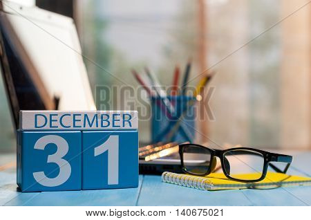 December 31st. Day 31 of month, calendar on workplace background. New year at work concept. Winter time. Empty space for text.