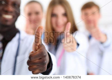 Group of medicine doctor hands show OK or approval sign with thumb up. High level service best treatment 911 healthy lifestyle satisfied patient therapeutist consultation physical concept