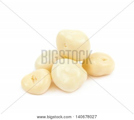 Pile of the white chocolate candy balls isolated over the white background