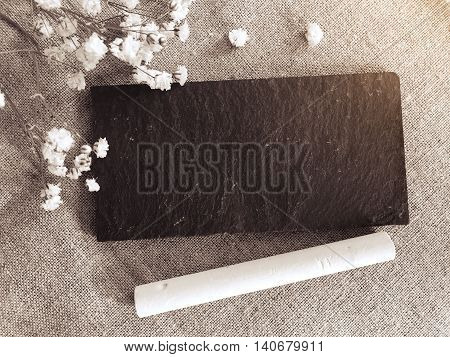 small chalk board background with flower in black and white style
