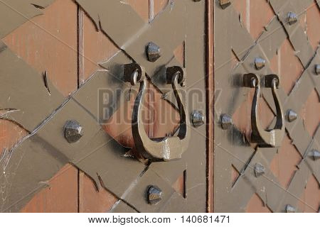 the detail of an old gate .