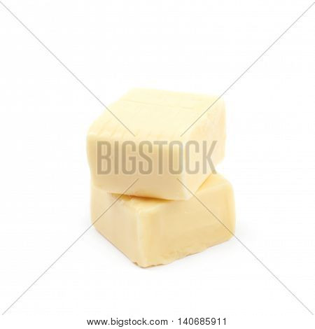 Composition of two chewing cuboid-shaped candy gums isolated over the white background
