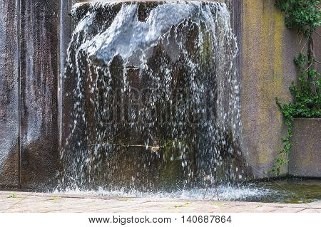 Artificially designed waterfall fountain - Fountain in a park.