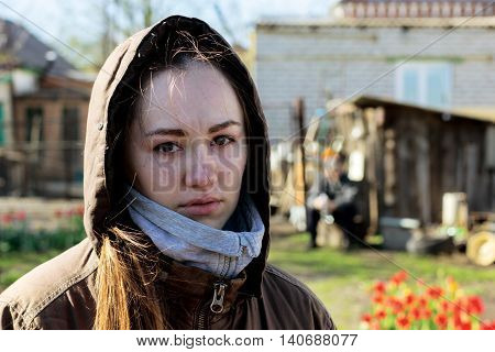 Crying girl. Puffy eyes tears on face. Emotional portrait of beautiful brunette. Depression and sadness
