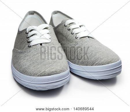 Grey sneakers or sneaker shoes, isolated on white background.