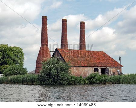 Old Lime-kiln Factory in red coloured Bricks at a river