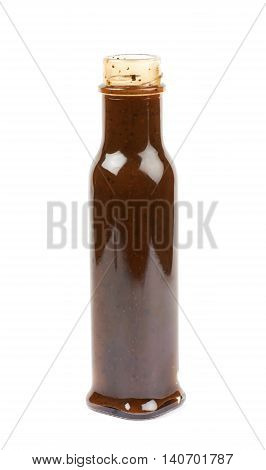Glass bottle of barbecue bbq sauce isolated over the white background