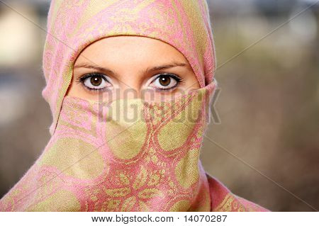 Muslim Woman Hidden Behind A Scarf