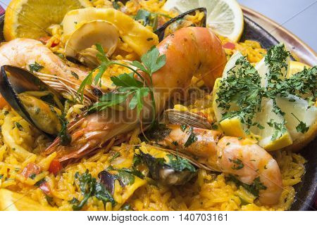 tradirional spanish cuisine paella with shrimps and vegetables