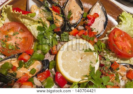 traditional spanish paella with mussels and vegetables