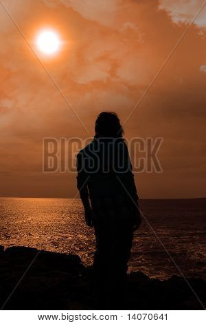 Silhouette Of A Sad Lone Woman On Irish Cliff Edge