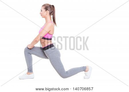Young Female Working Out Standing In Lunge Position