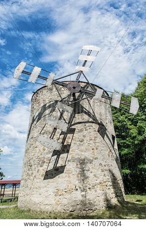 Old tower windmill in Holic Slovak republic. Architectural theme. Vertical composition. Cultural heritage. Beautiful object. Travel destination.