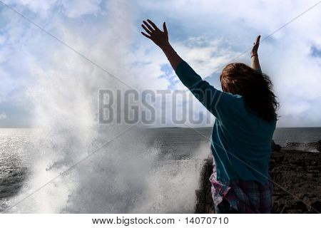 Silhouette Of Lone Woman Facing A Giant Powerful Wave