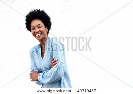 Smiling Young Black Woman Standing With Her Arms Crossed