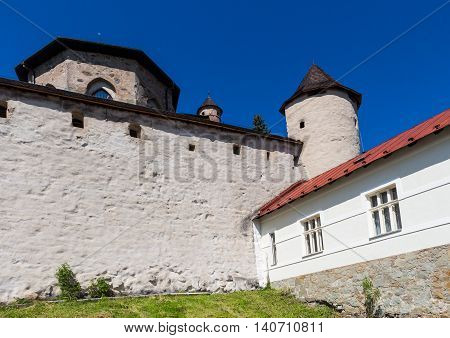Part of a fortification of the Old Castle in the city Banska Stiavnica Slovakia. Summer blue sky.