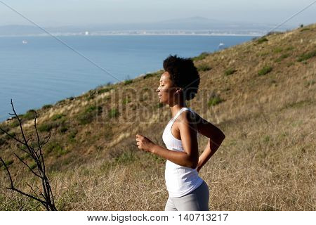 Healthy Young Woman Running On Mountains