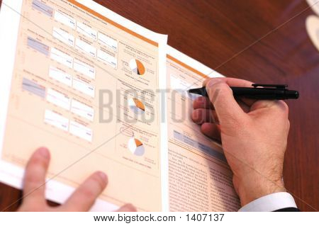 Businessman Is Writing Financial Report  1