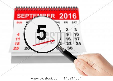 Labor Day Concept. 5 september 2016 calendar with magnifier on a white background