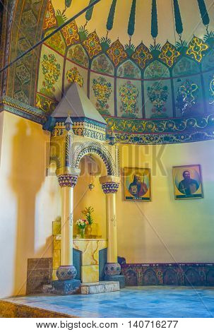 VAGHARSHAPAT ARMENIA - MAY 30 2016: The Altar of St John the Baptist in Etchmiadzin Cathedral decorated with carved columns and painted patterns on May 30 in Vagharshapat.