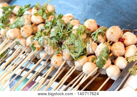 pork meat ball grill. Thai snack on stainless tray sale at food street