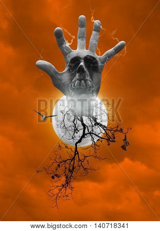 Hand blend with human skull smoke dead tree bird fly bat scream over moon and dark strom sky orange tone Halloween concept