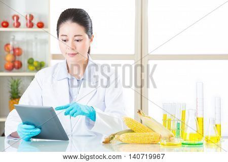 Asian Female Scientist Touch The Digital Tablet To Research For Genetic Modification
