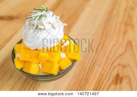 Korean style fresh mango shaved ice on wood table