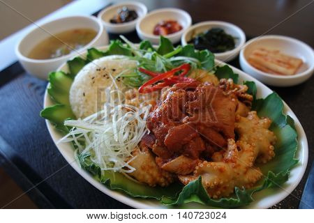 Korean styke of rice meal called jjukkumi with rice and fried octopus beef and herbs