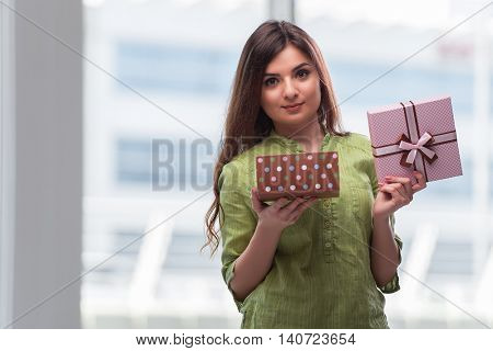 Young woman excited with giftbox
