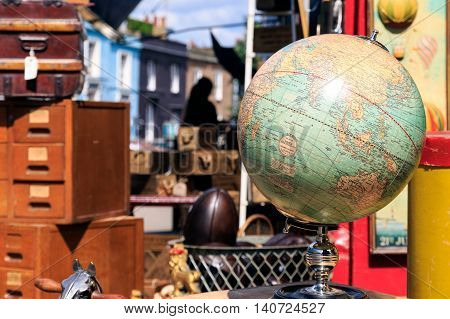 London, UK - July 13, 2016 - Antique globe displayed outside a shop at Portobello Road Market in Notting Hill