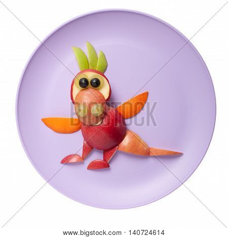 Amusing dragon made of apple on pink plate