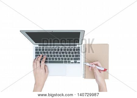 Closeup woman hand typing on keyboard at the gray notebook computer at left hand and hold a pen in right hand in work concept isolated on white background