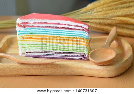 Crepe Cake Rainbow on the wood plate