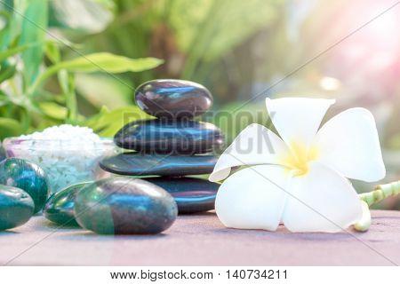 Spa treatment with Frangipani and black stones.