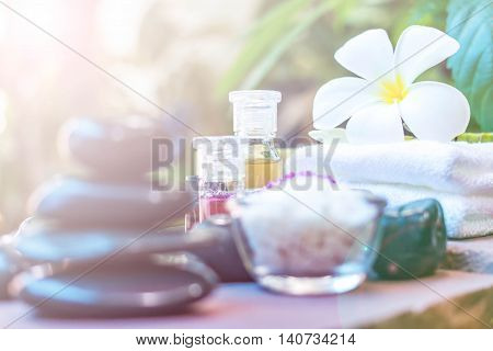 Spa accessories Rolled towel pampering stuff and frangipani flowers.