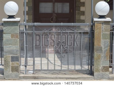 Gate at the entrance to a private house