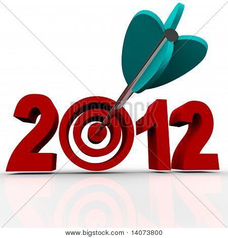 Jahr 2012 In roten Zahlen mit Pfeil im Ziel Bulls-eye