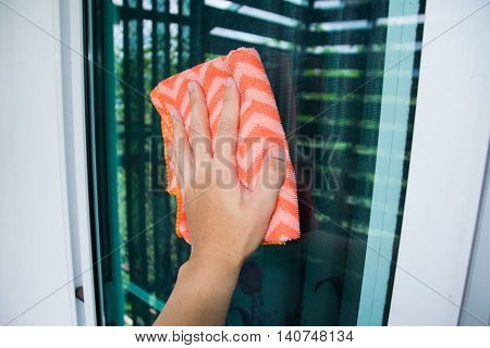 Holding Glass Wipes on window glass at home