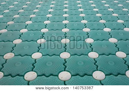 Closeup Pontoon green and white dot background texture