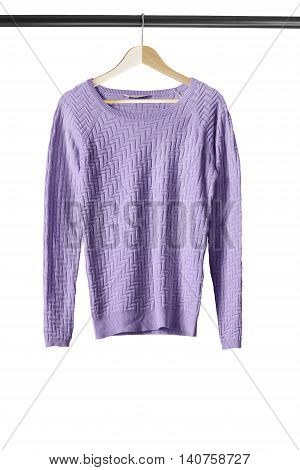 Purple pullover on wooden clothes rack isolated over white