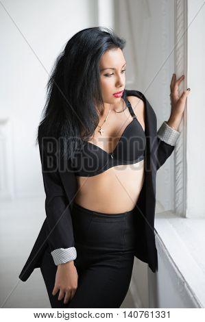 Sexy Brunette Near The Window