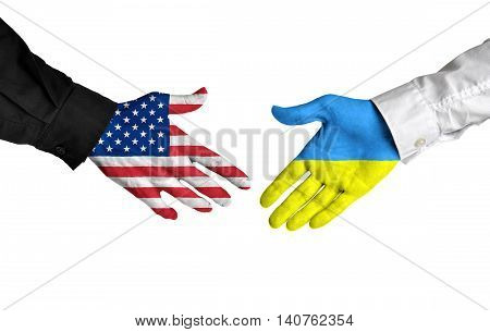United States and Ukraine leaders shaking hands on a deal agreement
